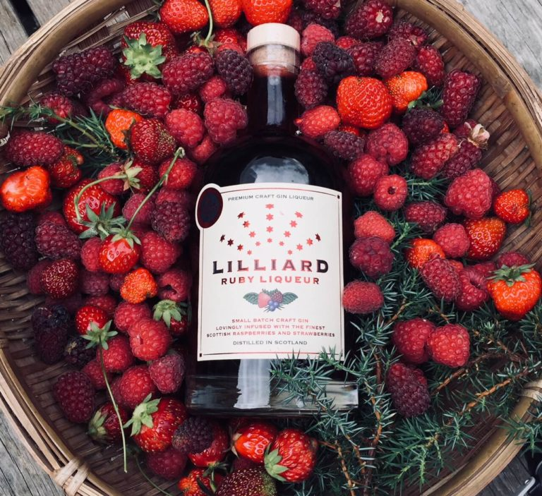 Lilliard Ruby Gin Liqueur in a basket of fruit