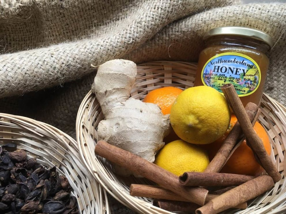 Tea accompaniment suggestions including cinnamon sticks, lemon, ginger and honey