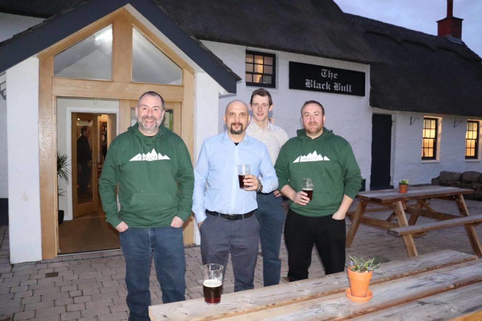 Team photo outside pub