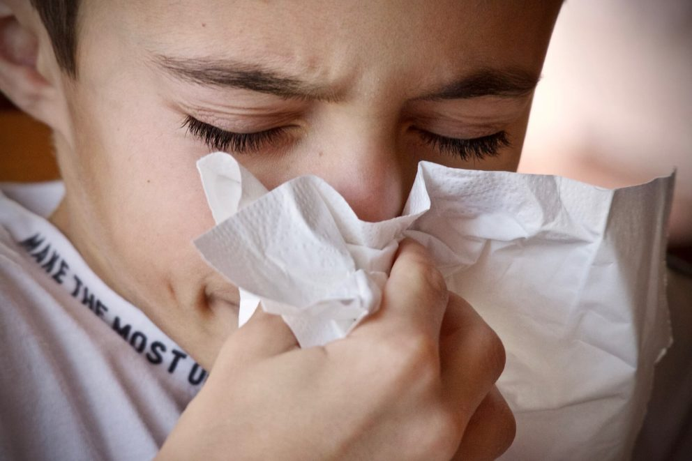 Blowing nose with tissue